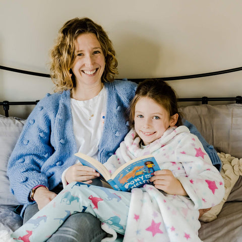 Parent and child reading together.
