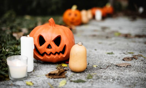 Halloween pumpkin and candles on a pathway