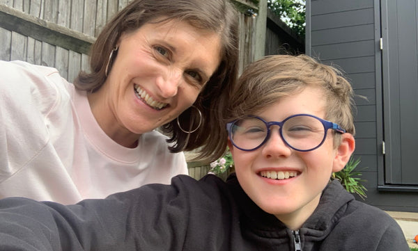 Parrot Street Book Club co-founder Sarah Campbell with her son.