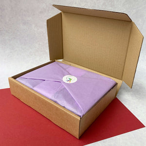 Book gift set for kids who love to read, wrapped in tissue and sent in a box.