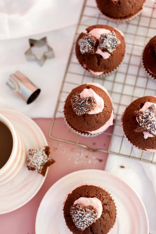 Vertical photo of chocolate cupcakes on a cooling rack