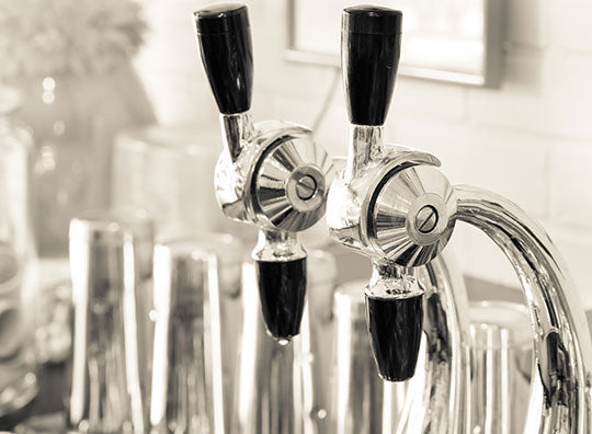 Closeup image of retro soda fountain nozzles