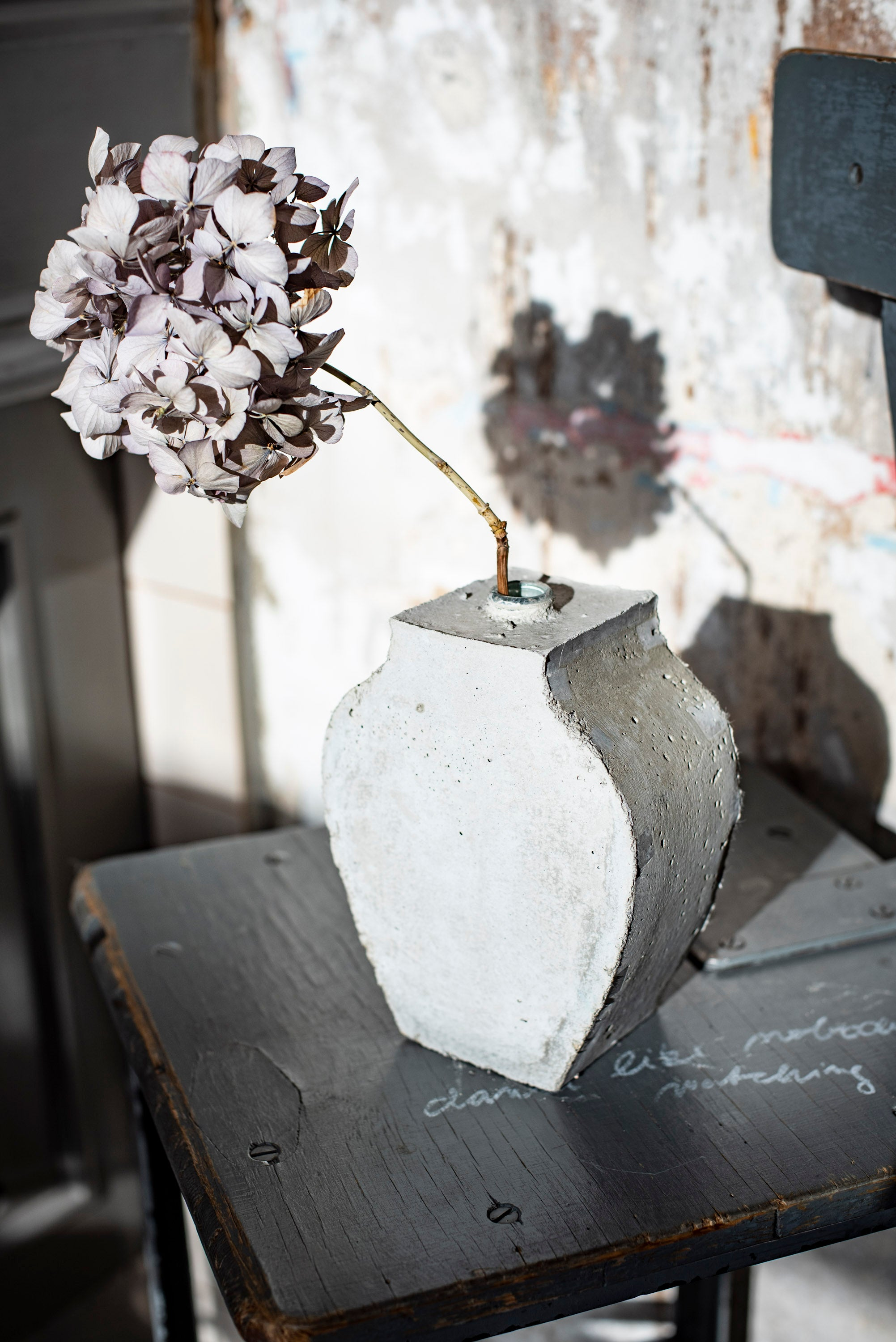 Art vase created by the Prague artist Petra Svejdarova a.k.a. Prasklo. Used materials are recycled glass and raw concrete without any plastificators.
