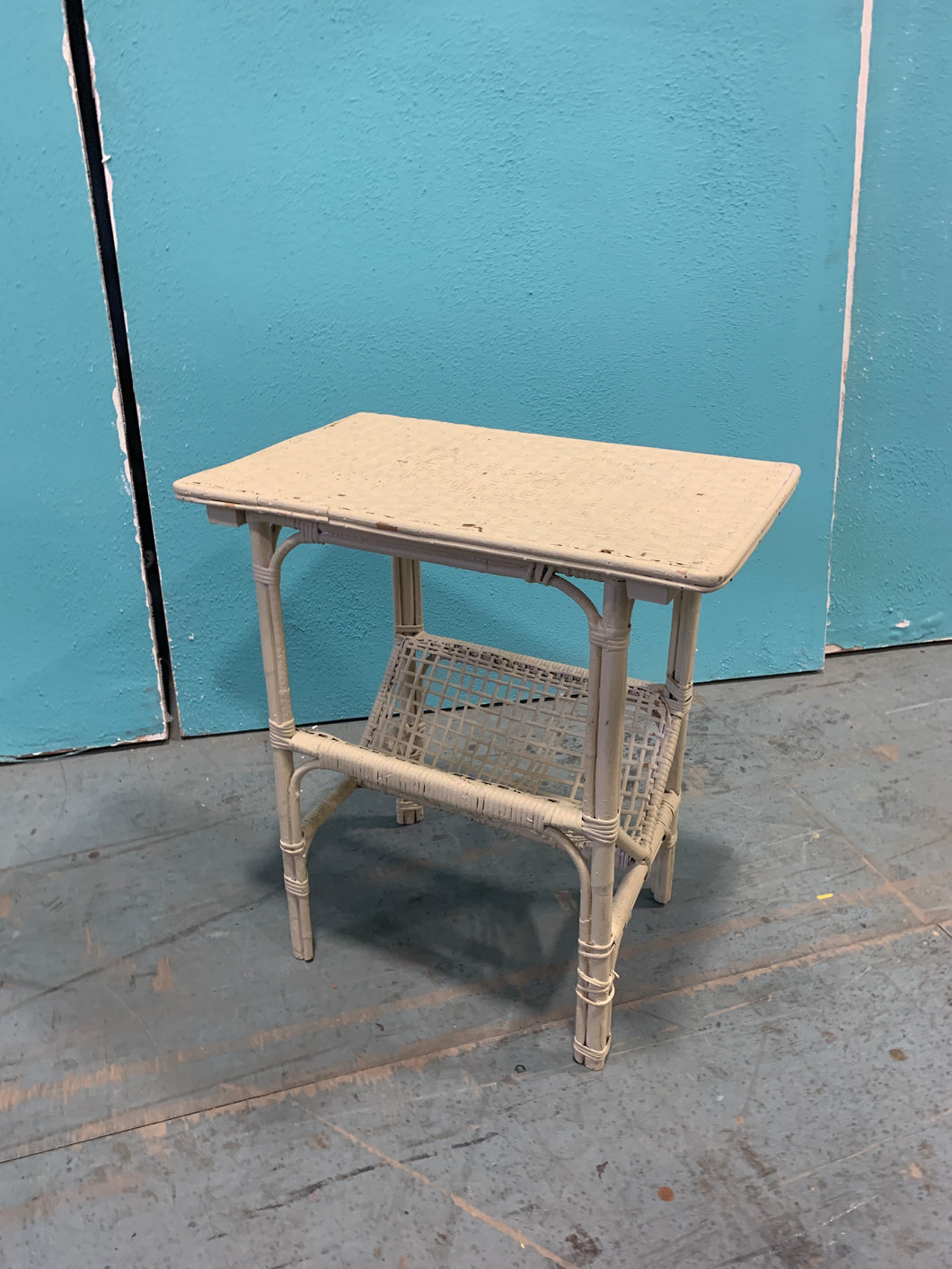 Small off-white painted rattan side table