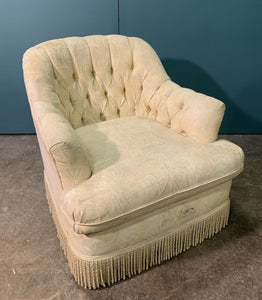 Cream upholstered armchair