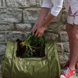 compost_rollmix_being_filled_by woman
