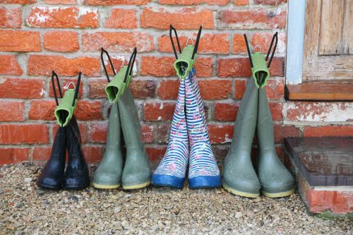 new garden products Haxnicks' Boot Clamps to protect from rain against a brick wall