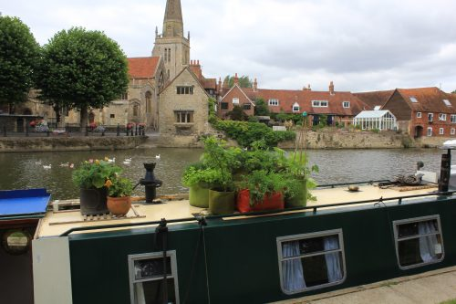 Haxnicks patio planters on the roof of a river boat