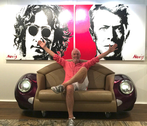 Artist Barry Novis with his portraits of Lennon & Bowie