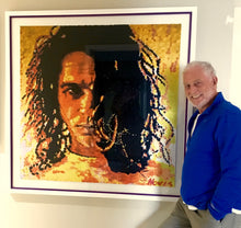 Load image into Gallery viewer, Artist Barry Novis with his framed Michael Hutchence print.