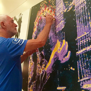Artist Barry Novis hand-finishing an enhanced art print of Jimmy Page