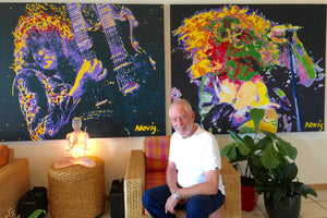 Artist Barry Novis with is Led Zeppelin enhanced prints