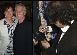 Jimmy Page with artist Barry Novis, and Jimmy Page signing his portrait