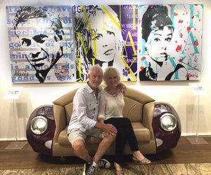 Artist Barry Novis & partner with portratis of McQueen, Bardot and Hepburn