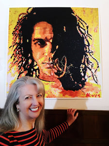 Tina Hutchence with the Novis portrait of her brother Michael Hutchence