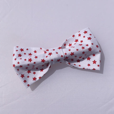 Dog bow tie red stars white background