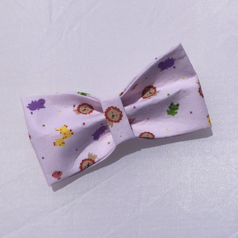 lion, hippo, giraffes, frogs and birds on light pink fabric front of tie