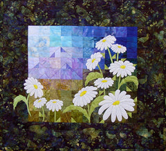 A Freshness of Spring - quilt pattern by Ruth Blanchet of applique diasies and patchwork background of mountains