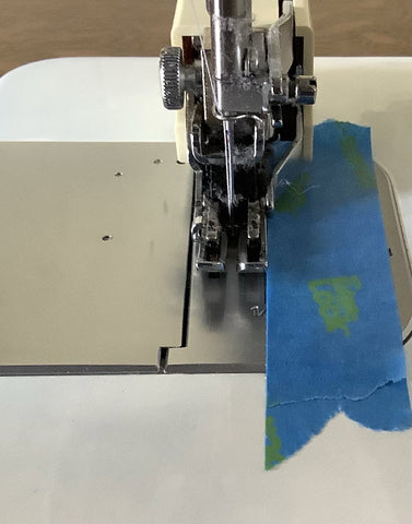 """1/4"""" bridge made of tape stuck to sewing machine for accurate seams"""