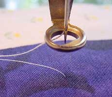 bobbin thread pulled up to top through layers
