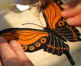Attach the butterfly and add antennae