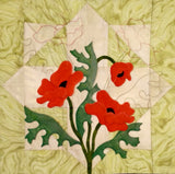 Patchwork block with applique poppy flowers