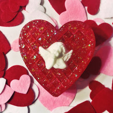 Load image into Gallery viewer, The red glitter heart-shaped trinket box with a white angel on top, in front of a background of felt hearts