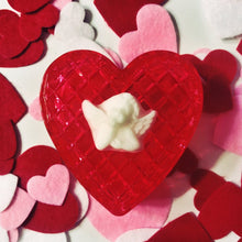 Load image into Gallery viewer, The red jelly heart-shaped trinket box with a white angel on top, in front of a background of felt hearts