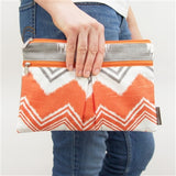 Logan and Lenora - Wet + Dry Diaper Clutch - Tangerine IKAT