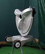 THE CHALLENGER PROGRAMMABLE PITCHING MACHINE