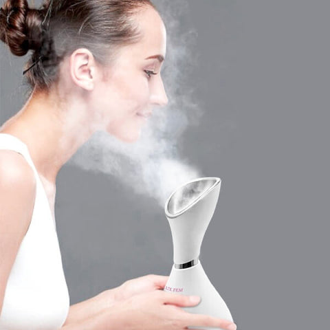 Using Lux Fem steamer to open the pores