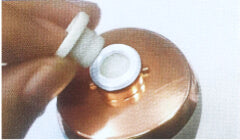 Insert a new cotton filter, ensuring the filter placed inside properly