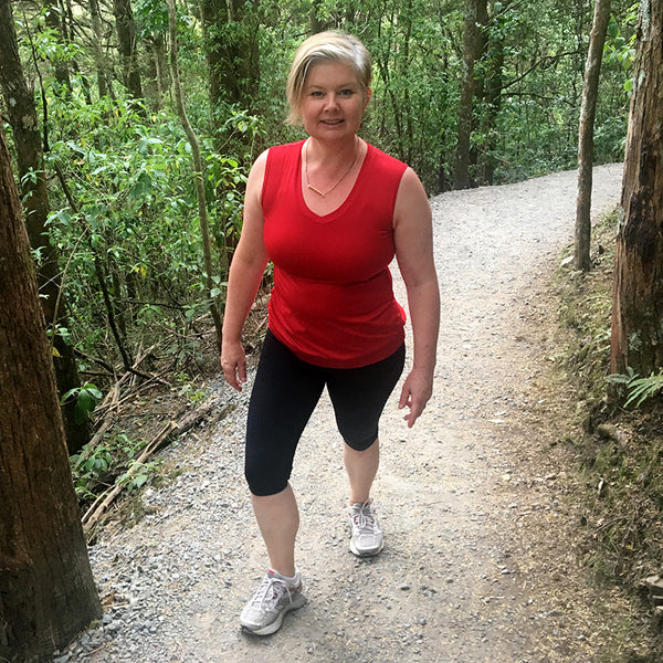 svvet real woman tramping through bushland in New Zealand