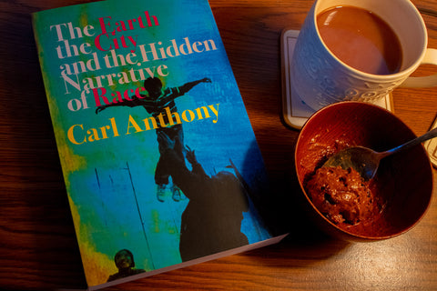 The Earth, The City, and The Hidden Narrative of Race by Carl Anthony next to Sweetness Gelato and Hot Chocolate