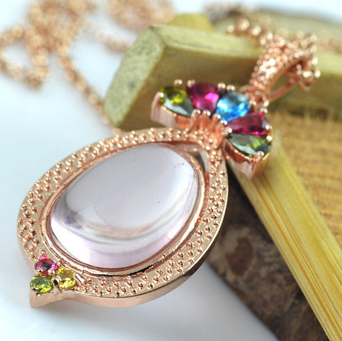 Large natural rose (pink) crystal quartz pendant with rose gold setting.