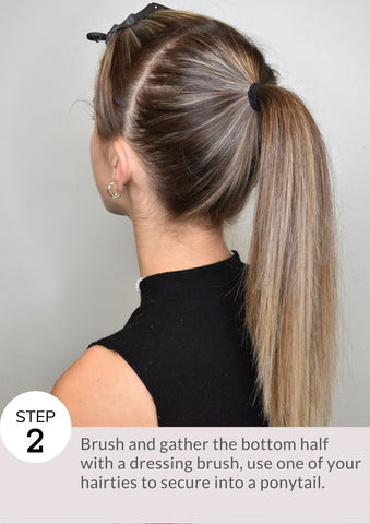 Step 2: Brush and gather the bottom half with a dressing brush, use one of your hairties to secure into a ponytail.