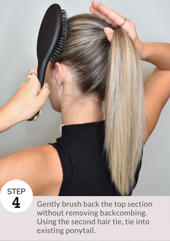 Step 4: Gently brush back the top section without removing backcombing. Using the second hair tie, tie into existing ponytail.