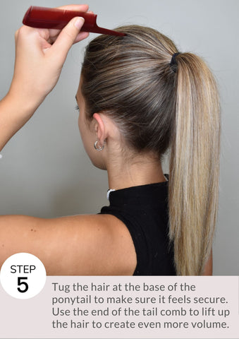 Tug the hair at the base of the ponytail to make sure it feels secure. Use the end of the tail comb to lift up the hair to create even more volume.