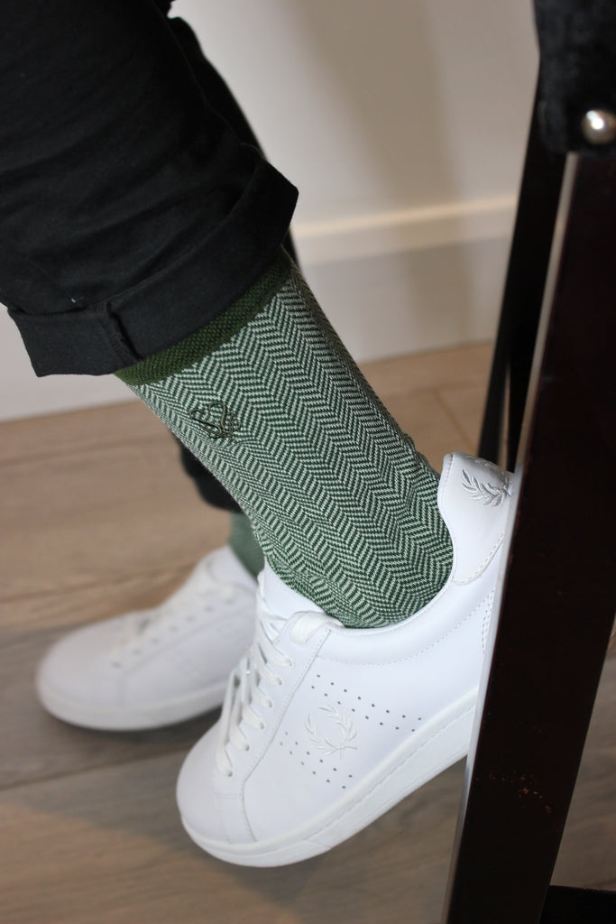 Green socks and white trainers