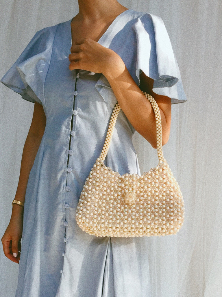 Oval Creamy White Beaded Bag