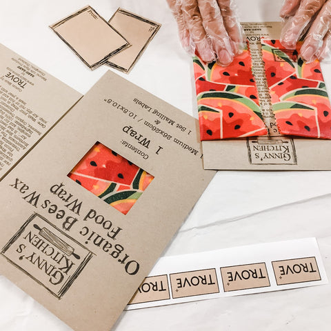 Food wraps being inserted into envelopes with TROVE labels