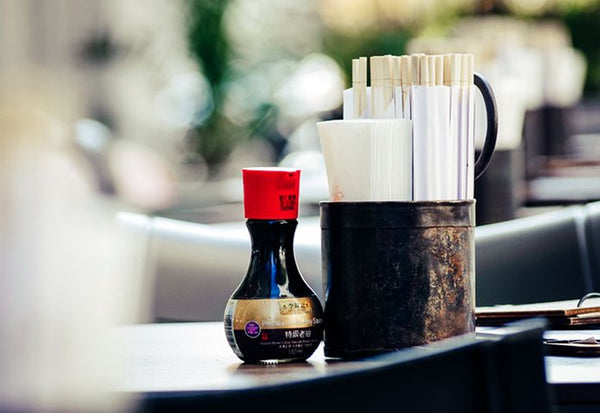 Soy sauce on table