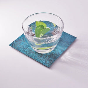 Blue Copper Coaster under a glass of water with mint leaves