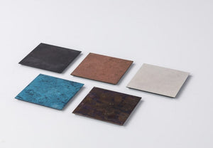 Display of handmade copper coasters in different colours - Suwada London - Made in Japan - Copperware for table