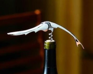 Suwada Wine Opener, presented on a bottle as a gift