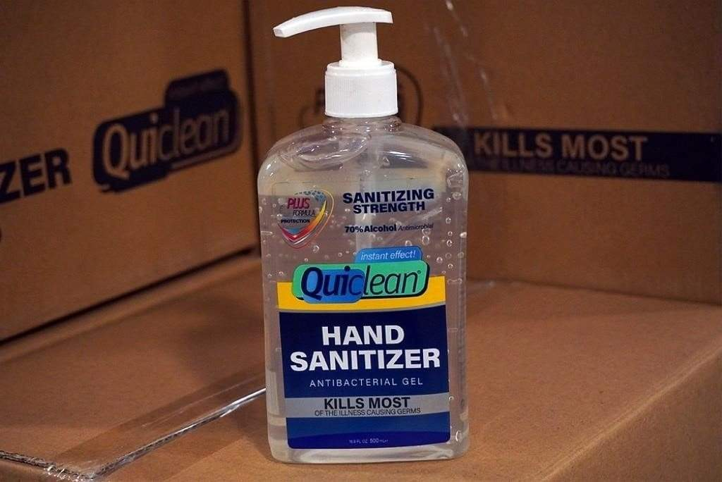 16 oz bottle of hand sanitizer sitting on boxes
