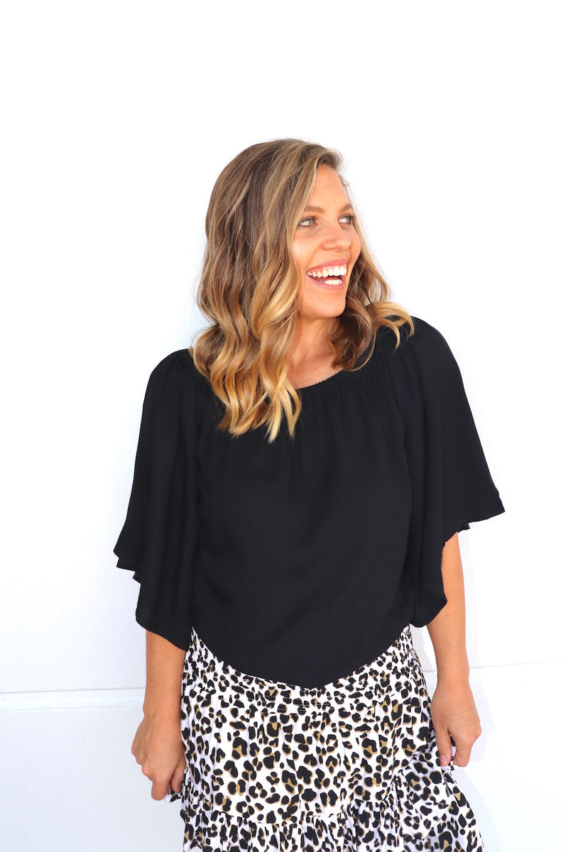 RO Wing On Or Off The Shoulder Top In Black