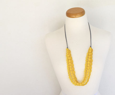Triple row bib style resin bead mix shape yellow
