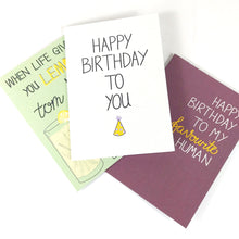 Load image into Gallery viewer, Pile of different card designs with the white birthday card at the top.