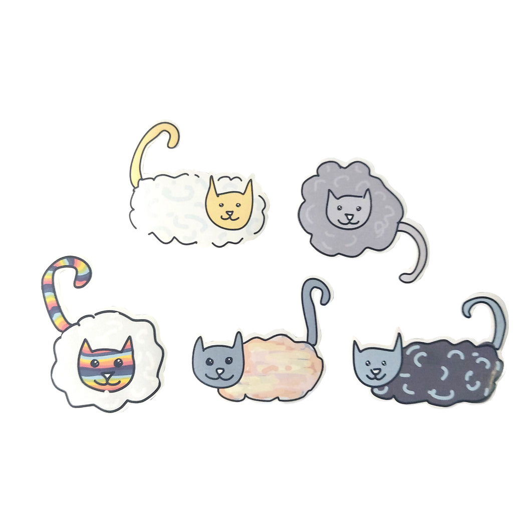 Cat stickers with clouds for bodies and regular heads and tails. The stickers are in a two, three formation, on a white background. Each sticker features a different set of colours.